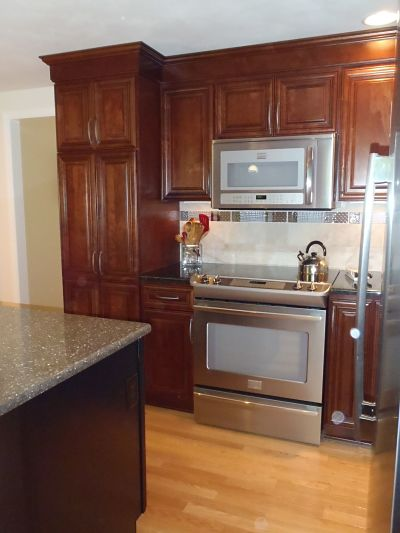 kitchen with stainless steel appliances and oak floors