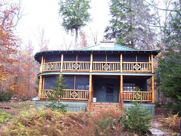 Adirondack cottage with upper and lower porches