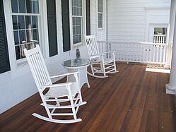Porch with white chairs