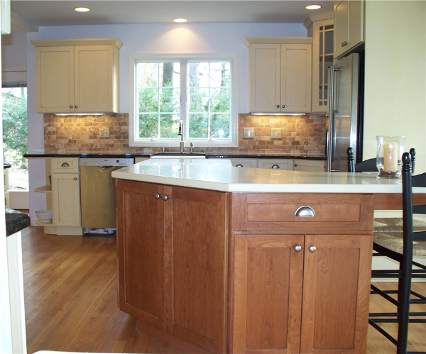 Combining stained cabinetry on the island and painted cabinetry along the perimeter creates a unique look in this kitchen remodel.