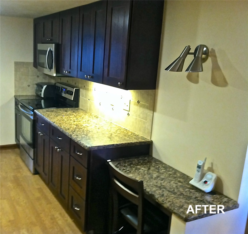 The addition of the new cabinets changed some of the functional space of the kitchen. A desk area for paperwork was factored into the design and placed at a lower height to break up the counter and provide a comfortable area for the homeowners to work. One of the updates is the vented microwave oven that replaced a range hood.