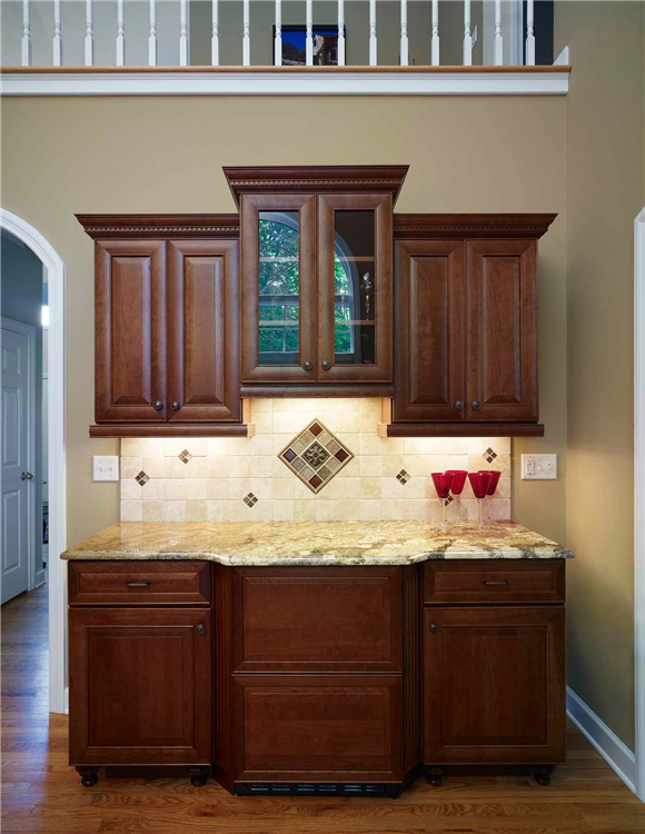 The addition of a dry bar in this kitchen remodel gave the owners a sizable area to store beverages and glassware.