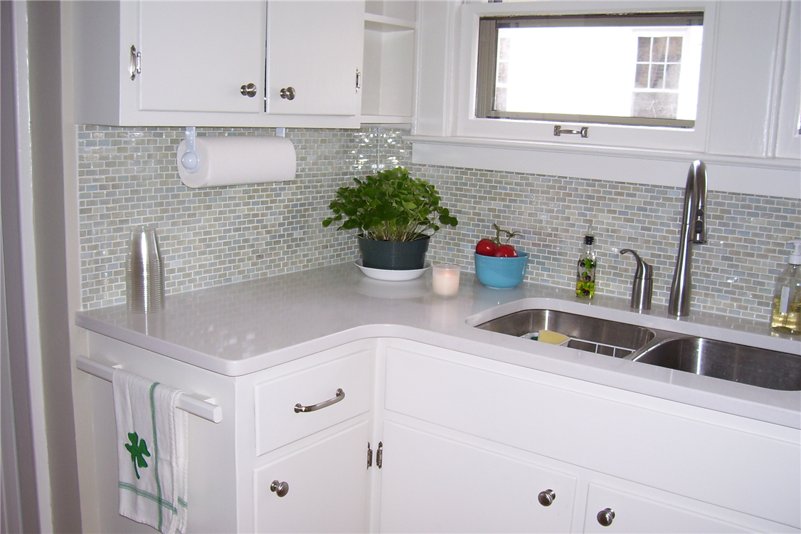 Clear glass mosaic tile backsplash roselawnlutheran adding new counters a glass tile backsplash and painting the cabinets created a nice upgrade dailygadgetfo Image collections