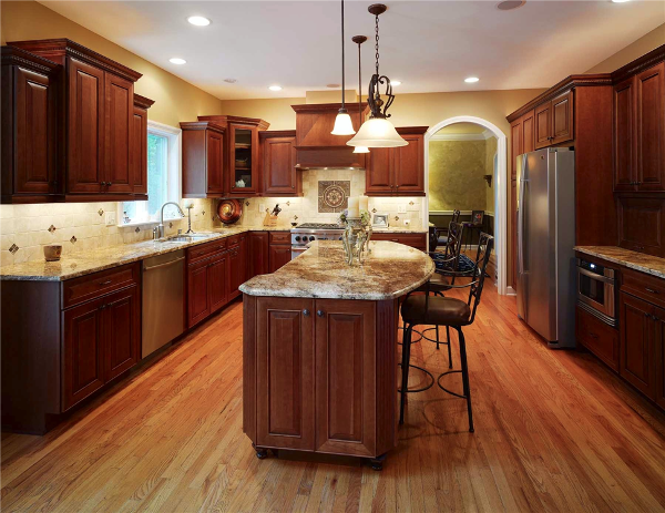 This large granite kitchen island is a great place to sit and socialize as well as work in this kitchen space.