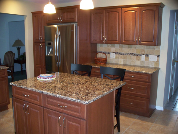 This kitchen remodel included constructing an island that would add counter space and some seating area but not be so large that it compromised the circulation space in the new kitchen.