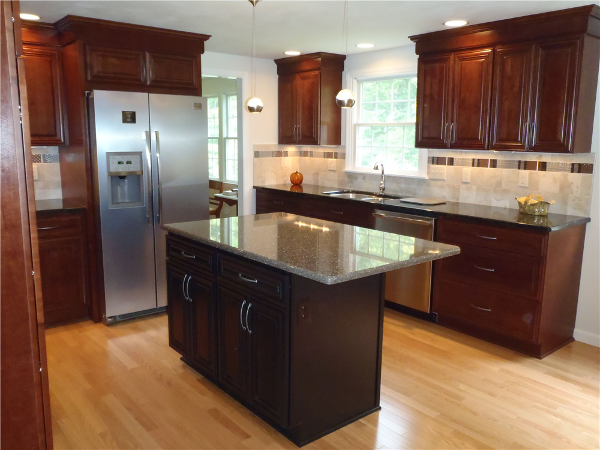 A new kitchen island with a quartz surface will provide space for storage, food prep and informal dining. The island is lighted by two contemporary pendant lights.