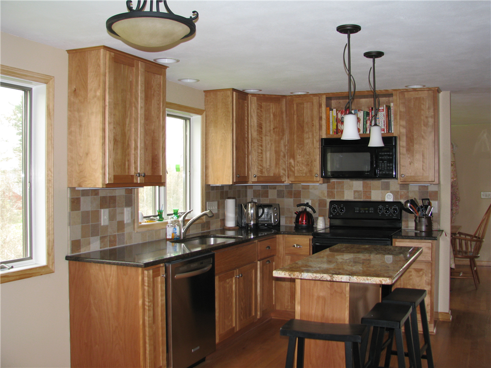 Switching the granite color on this kitchen island tops creates a focal point for this kitchen.