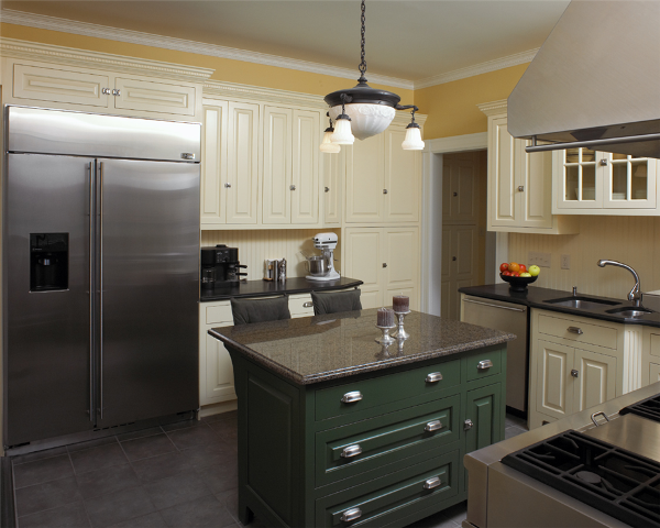 New, modern elements and stainless steel commercial grade appliances, are in distinctive contrast to the simpler, classic-style created by custom color cabinetry and the porcelain tile floor in this kitchen, beautifully bringing together the best of both worlds.