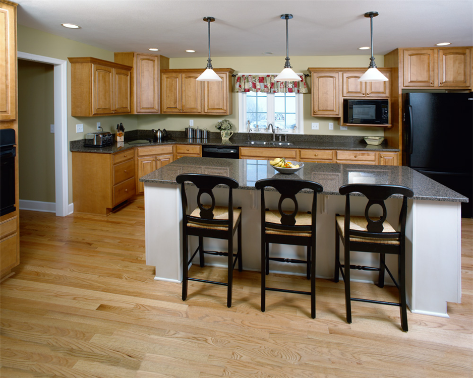 The large granite island is a wonderful place to gather and work in this kitchen.