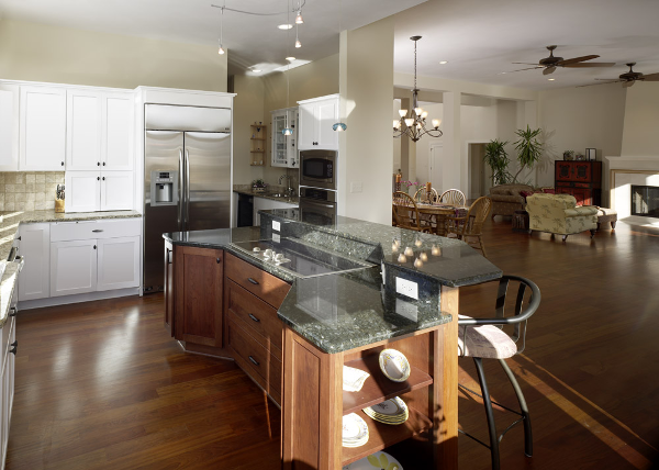 This open floor plan seamlessly integrates the kitchen and living room creating the appearance of more space. A tiered island provides space for food prep, cooking, storage and entertaining.