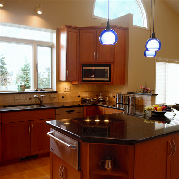 The new windows and lighting in this kitchen keep the kitchen bright day and night.