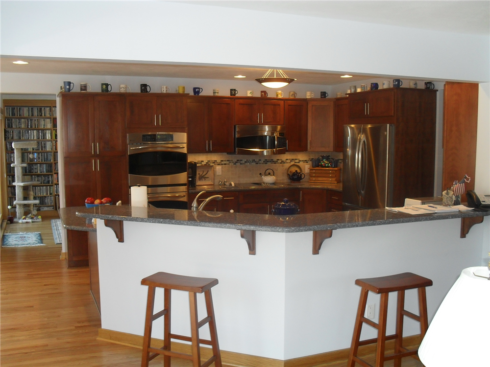 Removing this wall from the kitchen/family room made this a great space for entertaining.