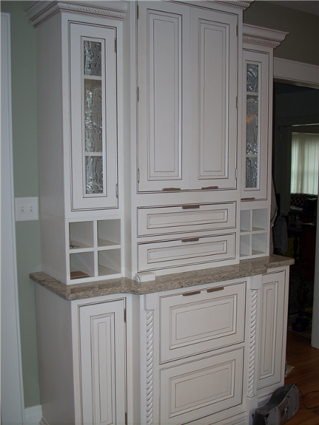 The glazed paint on these new kitchen cabinets brings out all of the details of the door profile and cabinet moldings.