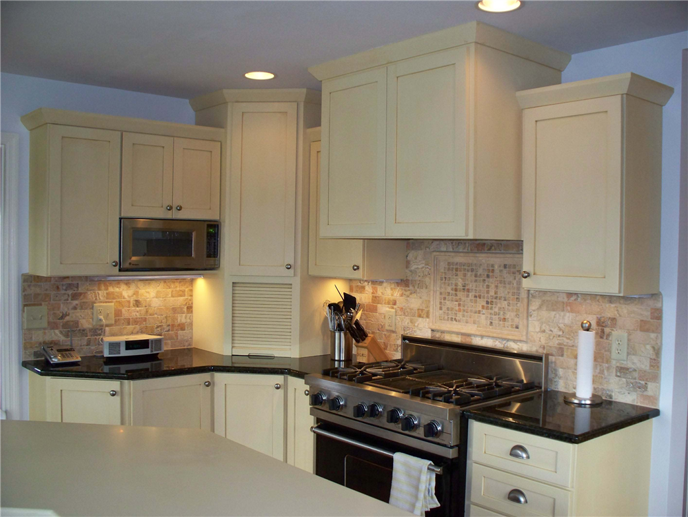 The stainless steel appliances in this kitchen add a nice accent to the painted cabinetry.