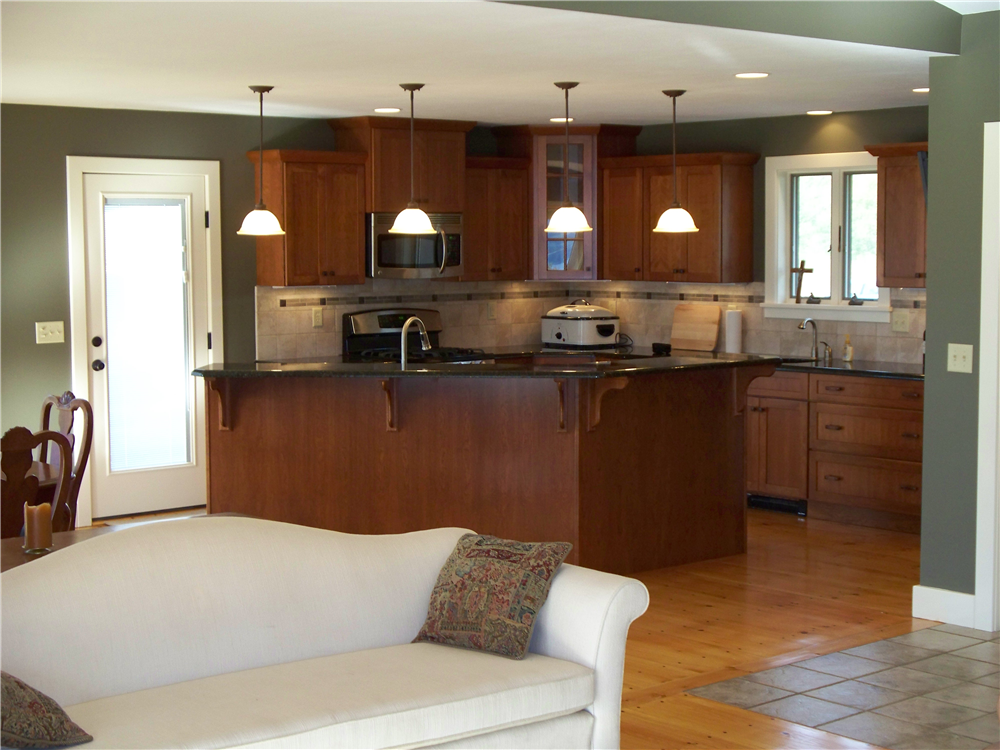 To add some additional appeal to this kitchen the upper cabinets were stepped and a glass door was applied to the raised corner cabinet.