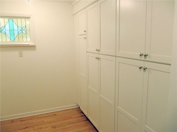 Holiday dishes, small appliances, paper supplies and large pots and pans are stored in floor to ceiling cabinets in the pantry area in the back of the kitchen. Pet supplies are also located in this space.