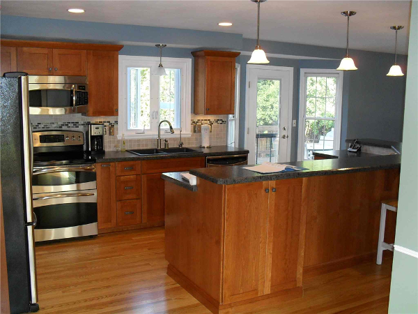 New Mission style cabinets and stainless steel appliances were added for function and to update the look.
