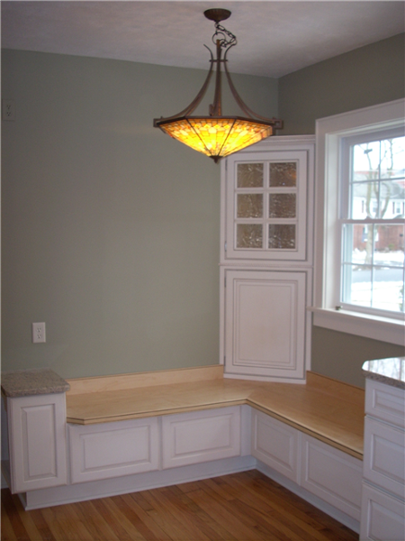 Once a table is added to this built-in window seat there will be plenty of seating in this small kitchen space.