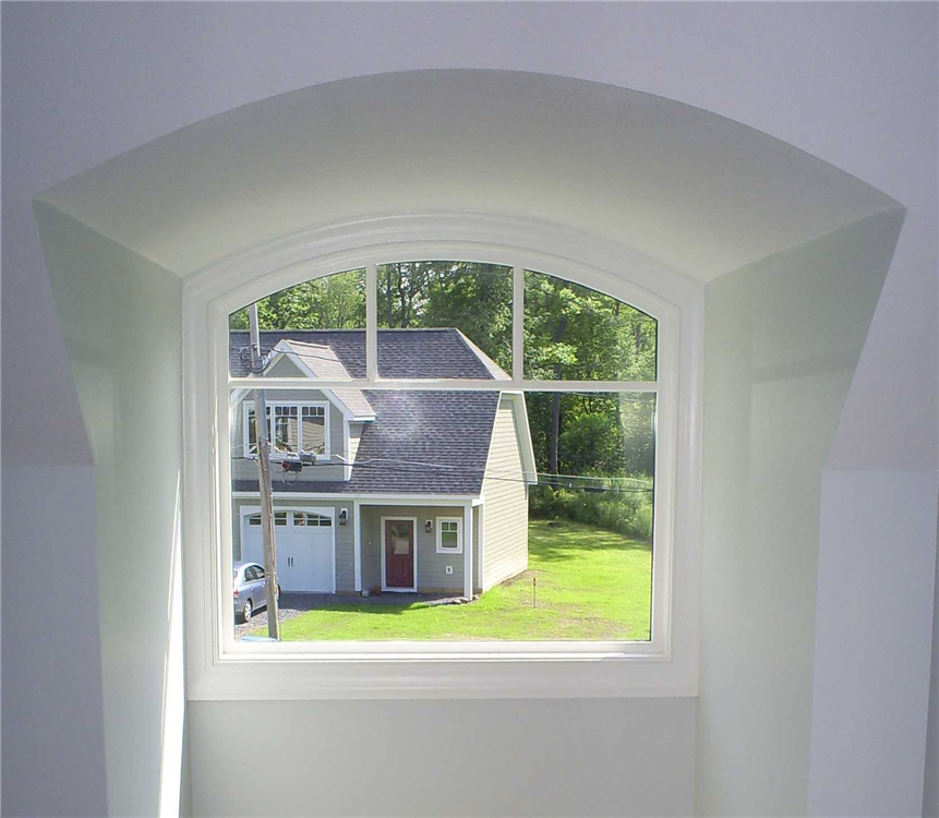The arch top window in this dormer creates interest from both the interior and exterior of the home. The barreled ceiling perfectly follows the contour of the window.