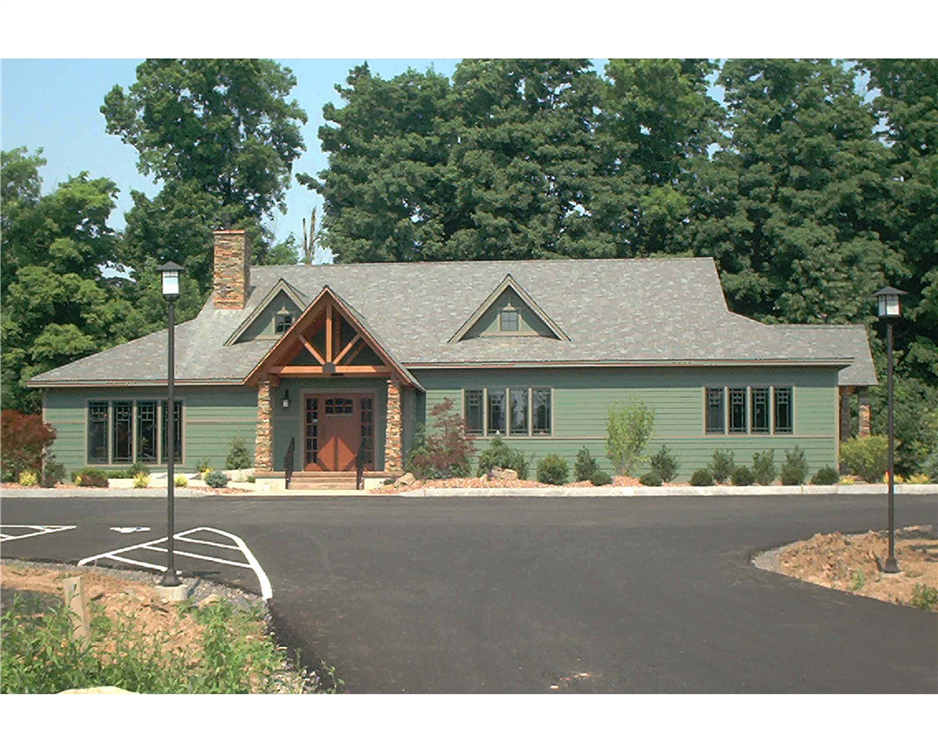 The windows and doors installed at this custom-built dental office greatly influence the look of the building. The windows include Prairie-style grilles between the glass. The entry door includes an arch top window with full-length sidelites on both sides.