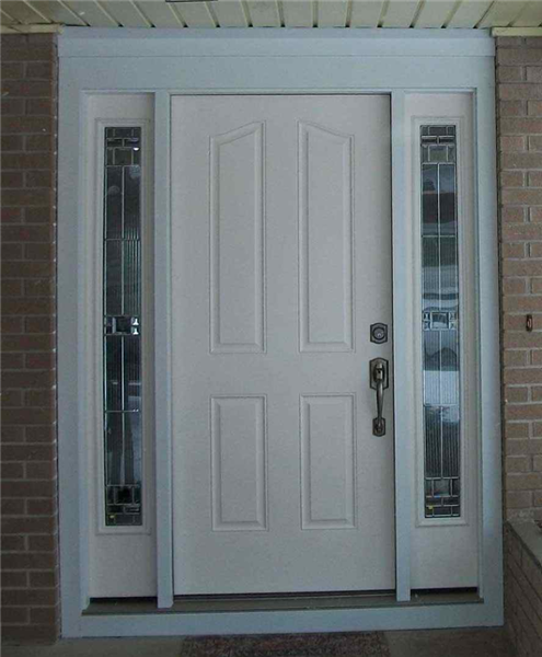 Brushed nickel caming and custom glass in the sidelights dress up this entry adding style and elegance.