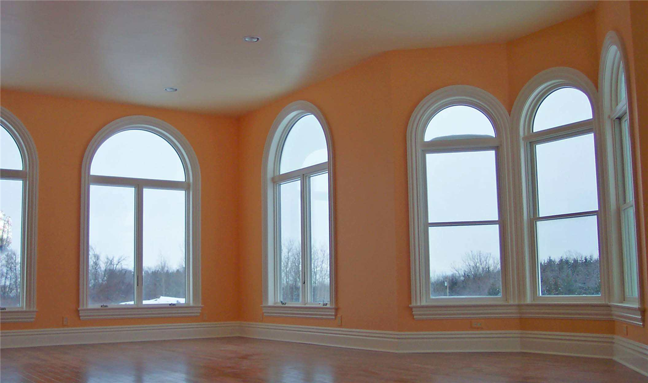 The glass on these large windows had to be tempered since they come so close to the floor elevation. The 10-foot ceilings and number of windows in this room create the sense of openness and grandness.