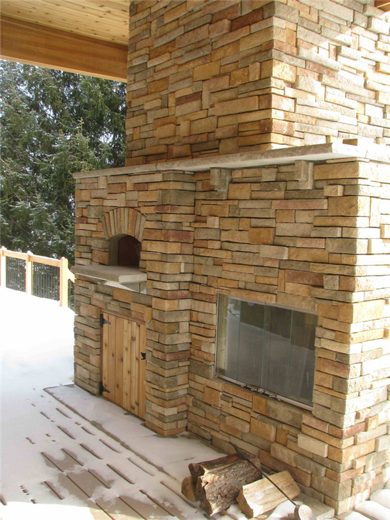 This composite deck features a custom fireplace, which includes an authentic wood-burning pizza oven. The fireplace is veneered with Cultured Stone.