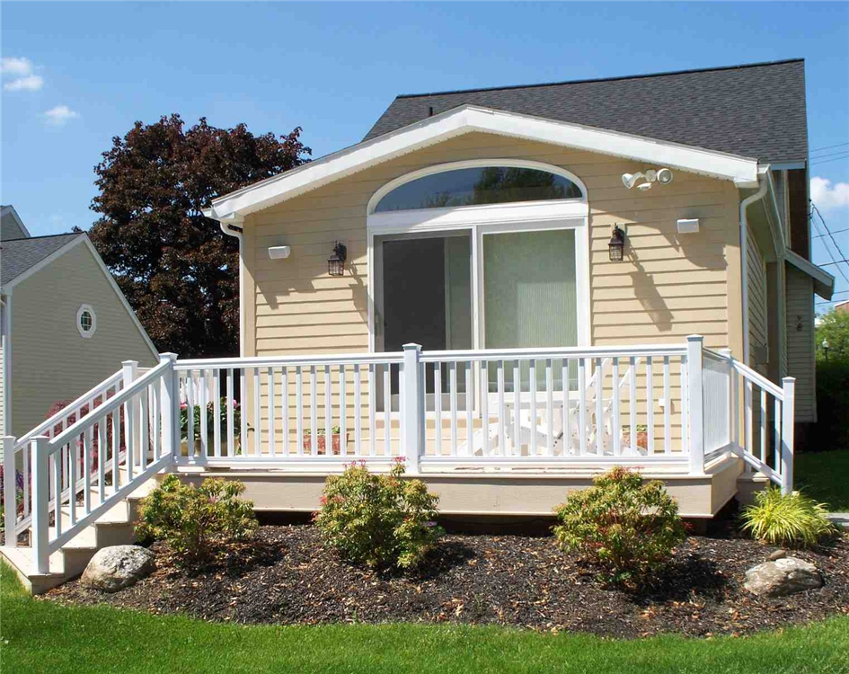 This two-tone maintenance free deck includes composite decking and trim boards accompanied by a vinyl rail system. This two-tone maintenance free deck includes composite decking and trim boards accompanied by a vinyl rail system.