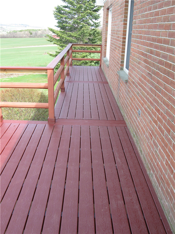 The old pressure treaded decking was replaced with new composite decking. The railings were salvaged and trimmed with composite material.