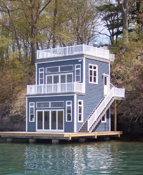 Located on Skaneateles Lake, this boathouse features vinyl siding and windows, two vinyl decks and a large first level deck/dock. Located on Skaneateles Lake, this boathouse features vinyl siding and windows, two vinyl decks and a large first level deck/dock.