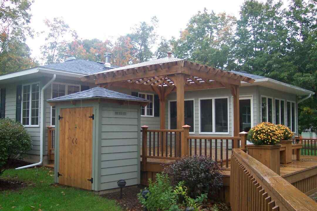 Sunshine or rain the covered pergola offers an attractive living space on the deck. A small storage building provides storage for tools and houses the in-ground pool's pump and heater.