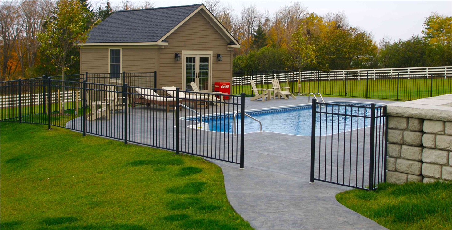 This two-level poolhouse provides plenty of room for outdoor furniture storage in the walkout bottom level and plenty of room for entertainment on the first level.