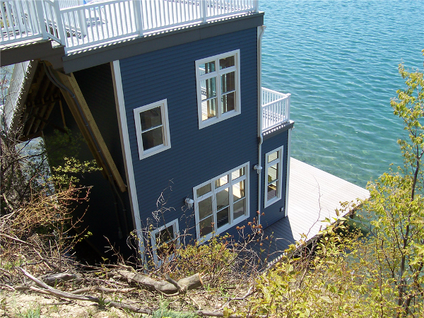The construction of this boathouse added additional usable space to this steep lake front property.