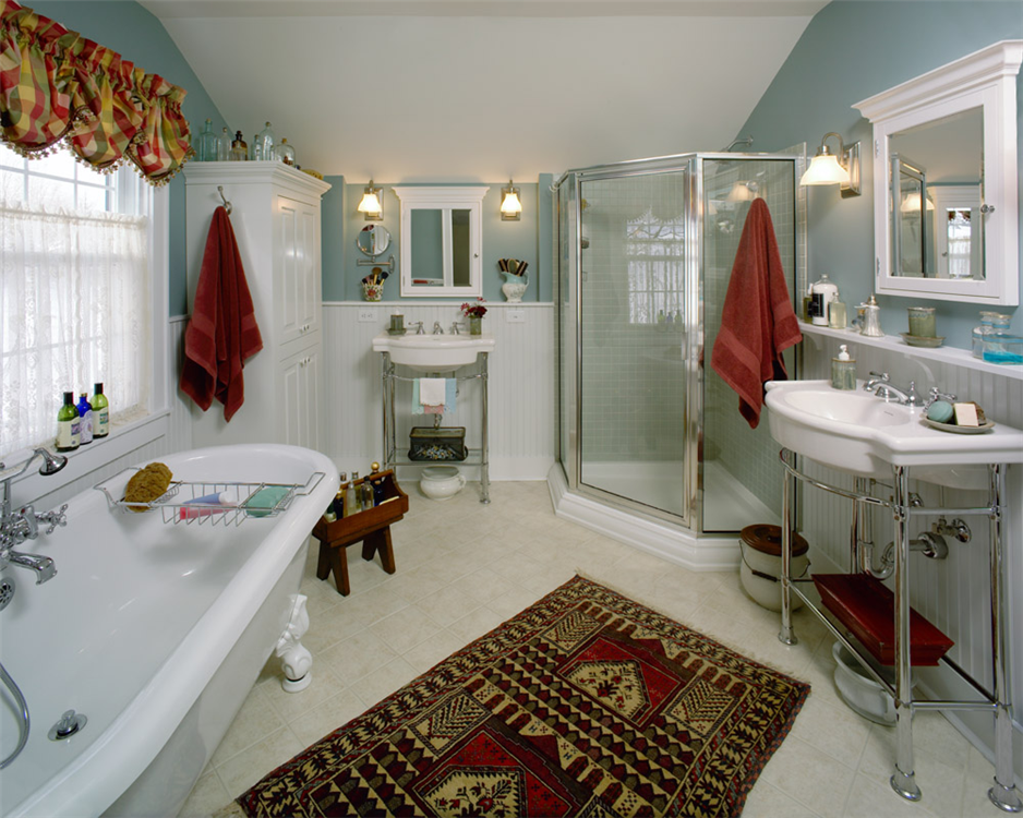 Both vibrant and calming colors help you relax and recharge. A neo-angle shower with tile walls, claw foot tub, built-in linen cabinet and two separate sink areas deliver good looks. The efficient design makes the most out of all the space in this bathroom.