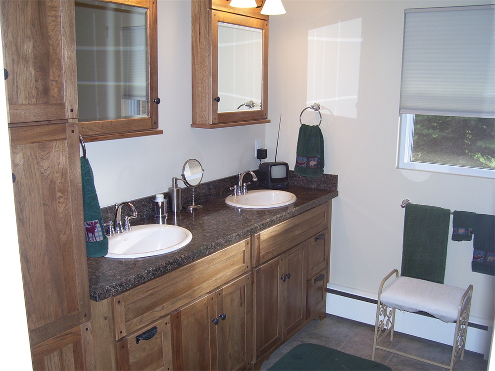 The two medicine cabinets, large vanity and linen cabinet create plenty of storage space in this bathroom.