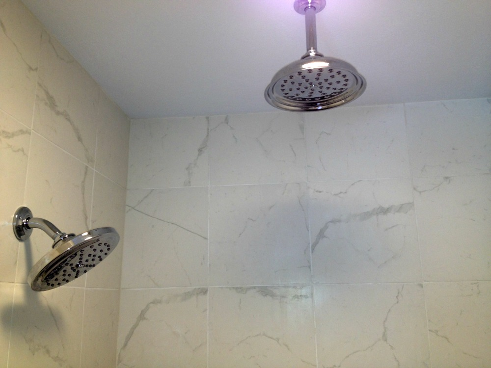 Two showerheads, a wall shower from Kohler and a waterfall shower from Moen, were installed.