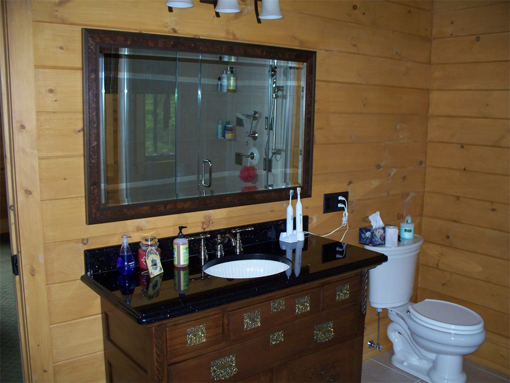 This vanity is truly a piece of furniture with a custom granite top and undermount sink.