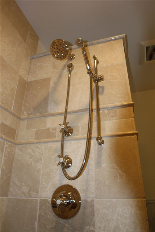 A handheld and rainfall shower were special-ordered for the shower.