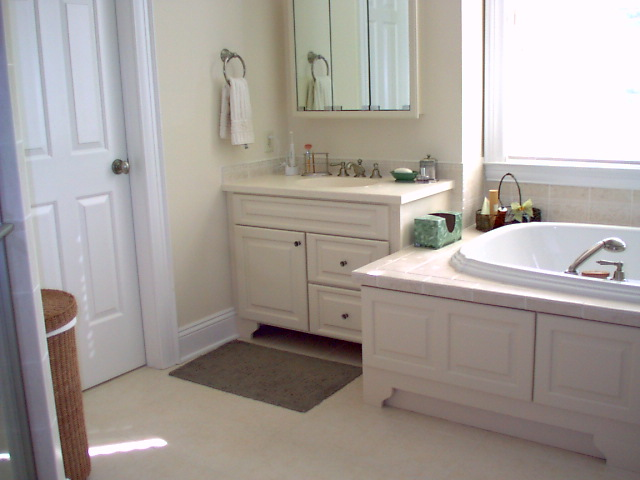 The painted cabinet door panels were installed o the face of this whirlpool to tie it into the painted vanity cabinets.
