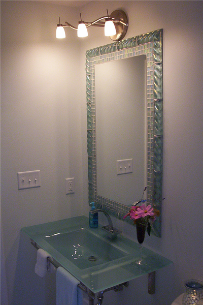 The two styles of glass tile created a unique frame for this mirror.