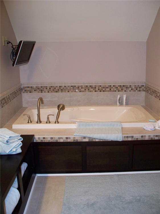 This bath remodel included a soaking tub with a flat screen TV.