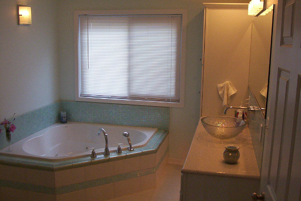 This bathroom remodel included a whirlpool tub with heater surrounded by glass tile to create a great place to relax.