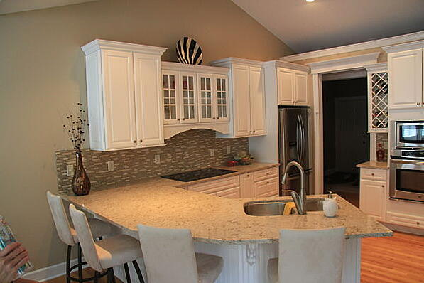 kitchen makeover with angular peninsula countertop