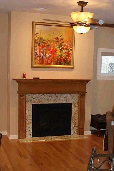 fireplace-with-wood-mantel-and-quartz-surround