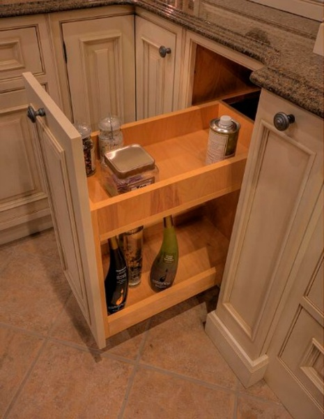 Base cabinet with pullout spice rack shelf from Elmwood Fine Custom Cabinetry.