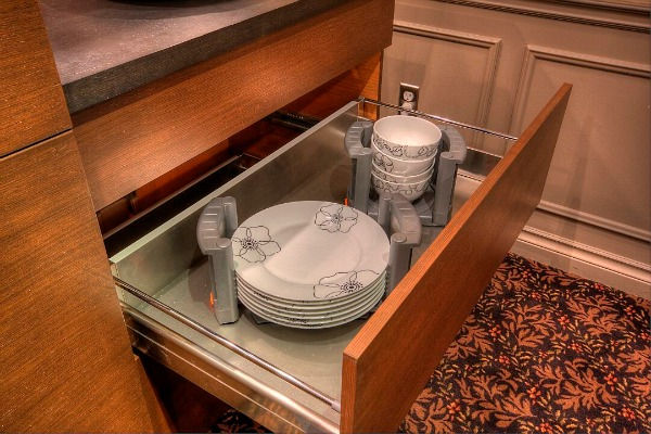 Cabinet drawer with plate organizers from Elmwood Fine Custom Cabinetry.