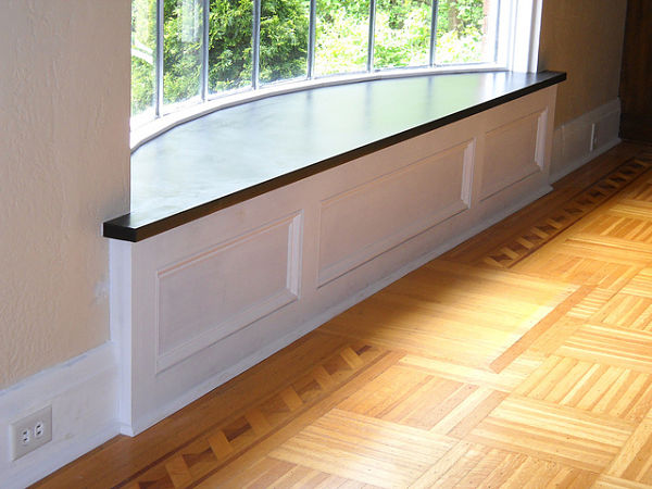 Decorative Baseboard and Stone Window Seat