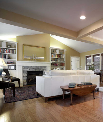 Open Living Room with Custom Fireplace Mantel and Bookshelves
