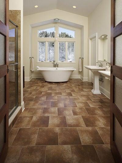 brown floor tile bathroom. master bathroom with cathedral ceiling brown floor tile e