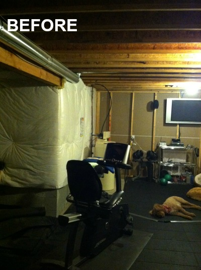 BEFORE-unfinished-basement-with-exercise-equipment